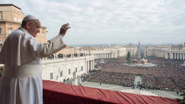 "EDITORIAL USE ONLY. NOT FOR SALE FOR MARKETING OR ADVERTISING December 25, 2014: Pope Francis delivers a ""Urbi et Orbi"" (to the city and world) message from the balcony overlooking St. Peter's Square at the Vatican."